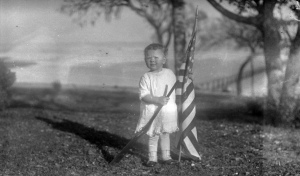Child with American flag and gun inTexas